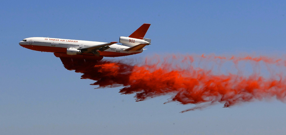 DC9  10 Tanker  water bomber which is being tested for its usefulness during bushfires. Drops a load of fire retardant near Avalon Airport 30/01/2010 Pic By Craig Sillitoe SPECIAL 000 melbourne photographers, commercial photographers, industrial photographers, corporate photographer, architectural photographers, This photograph can be used for non commercial uses with attribution. Credit: Craig Sillitoe Photography / http://www.csillitoe.com<br /> <br /> It is protected under the Creative Commons Attribution-NonCommercial-ShareAlike 4.0 International License. To view a copy of this license, visit http://creativecommons.org/licenses/by-nc-sa/4.0/.