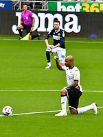 Football - 2020 / 2021 Sky Bet Championship - Swansea City vs Birmingham City - Liberty Stadium<br /> <br /> André Ayew of Swansea City takes the knee
