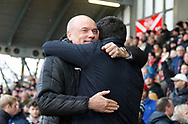Uwe Rosler Head Coach of Fleetwood Town and Blackpool's Manager Gary Bowyer embrace during the EFL Sky Bet League 1 match between Fleetwood Town and Blackpool at the Highbury Stadium, Fleetwood, England on 25 November 2017. Photo by Paul Thompson.