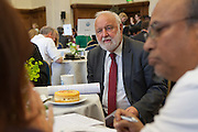 Frank Downson MP in discussion with his constituents at the Tea time for change event. Refreshing the call for justice. Organised by the UK's leading NGO's.  Enabling constituents to dicuss the subject with their MP.