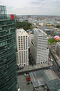 New offices and retail developments along the route of the former Cold War barrier which have sprung up since the Wall was opened 15 years ago on 9th November 1989. These buildings stand within what was no-man's lands between East and West Berlin and are viewed from the roof of the Chrysler-Daimler building, which houses the world's fastest elevator. Visible in the distance are the Brandenburg Gate and the Reichstag (parliament).