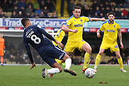 AFC Wimbledon midfielder Anthony Hartigan (8) and Southend United midfielder Timothee Dieng (8) battles for possession during the EFL Sky Bet League 1 match between Southend United and AFC Wimbledon at Roots Hall, Southend, England on 16 March 2019.