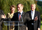 Oct. 04, 2011 - Charlottesville, VA. USA; Virginia Governor Bob McDonnell speaks in front of Donald Trump, right, and Patricia kluge, left, during a press conference announcing the grand opening of Trump Vineyard Estates Tuesday in Charlottesville, Va. Trump purchased the foreclosed vineyard, previously owner by Patricia Kluge, at auction earlier this year. The 2,000 acre Trump Vineyard estate is also the home to Trump Winery, helmed by Donald's son Eric Trump. (Credit Image: © Andrew Shurtleff)