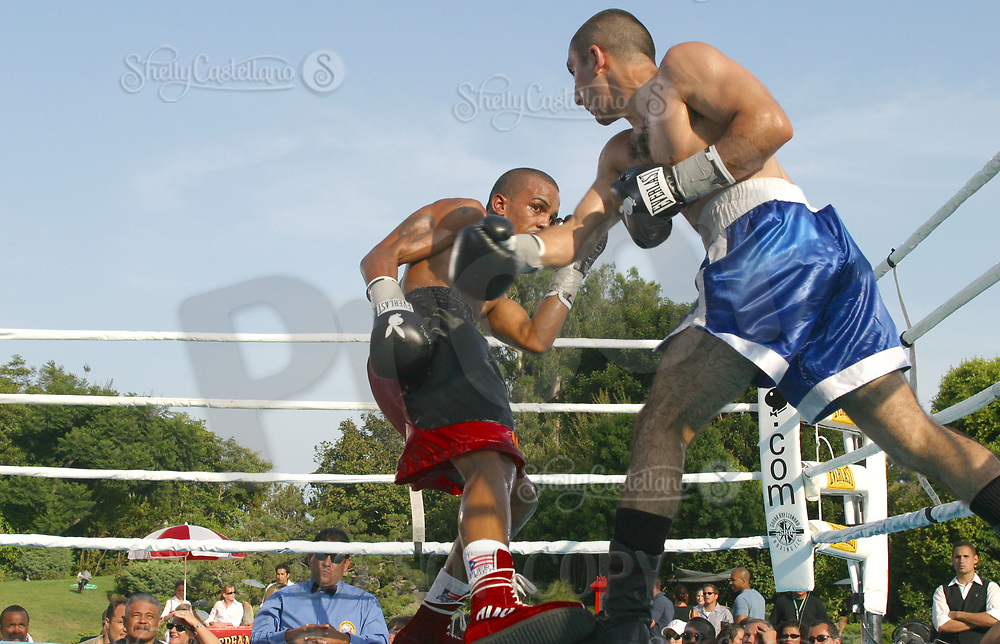 Jul 09, 2002; Los Angeles, CA, USA; Bantamweight boxer KAREN HARUTYUNYAN takes a punch at JOSE NIEVES @ Sugar Ray Leonard's Tuesday Night Fights on ESPN2 live from the Playboy Mansion.<br />Mandatory Credit: Photo by Shelly Castellano/ZUMA Press.<br />(©) Copyright 2002 by Shelly Castellano