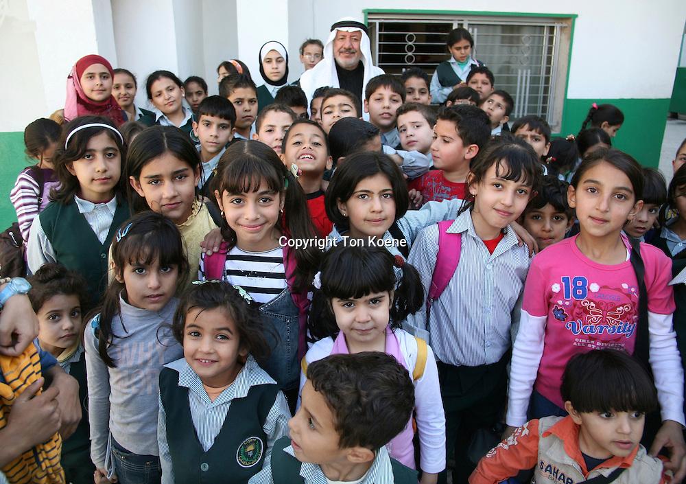 The school director and students in  Amman, Jordan