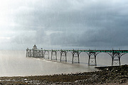 UK Victorian Pier at Clevedon on the Southwest Coast of England on a very rainy and stormy evening.  Licensing and Limited Edition Prints.