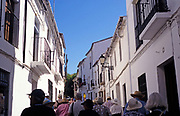 A group on a guided tour through the narrow streets of Ronda, Spain