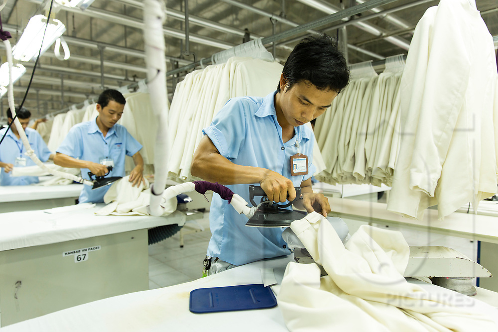 Ironing station in Hansae textile factory, Cu Chi, Ho Chi Minh city, Vietnam, Southeast Asia
