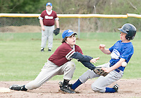 Laconia Savings Bank's 2nd baseman, Tommy Hart, can't get hold of the ball as Cantin's Max Troiano makes it safely on base during their opening day game for Gilford's Cal Ripken League held at Francouer Field in Gilford Village.  (Karen Bobotas/for the Laconia Daily Sun)