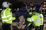 Police arrest a person as they clash with protestors over Westminster Bridge in central London on Sunday, Jun 7, 2020, during a rally, to protest against the killing of George Floyd by police officers in Minneapolis, USA. Floyd, a black man, died after he was restrained by Minneapolis police while in custody on May 25 in Minnesota. (Photo/ Vudi Xhymshiti)
