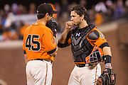 San Francisco Giants starting pitcher Matt Moore (45) and catcher Buster Posey (28) have a meeting at the pitching mound against the St. Louis Cardinals at AT&T Park in San Francisco, Calif., on September 16, 2016. (Stan Olszewski/Special to S.F. Examiner)