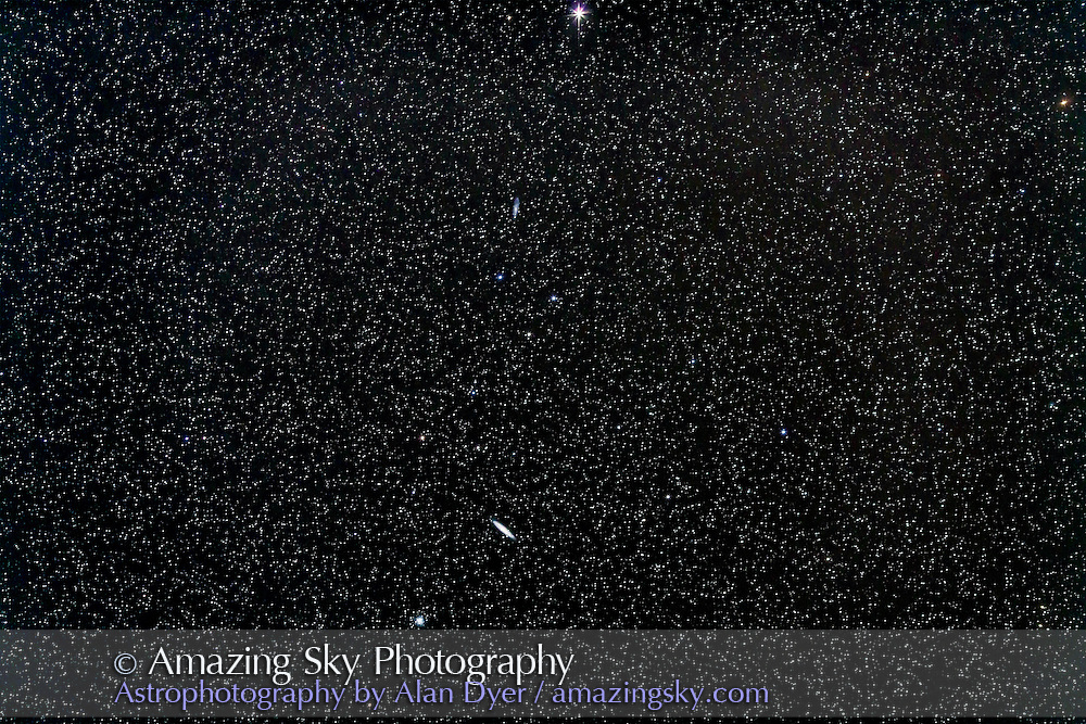 NGC 247 the large edge on galaxy in Sculptor, above, with NGC 253 and NGC 288 below, in a shot with a 135mm telephoto lens to simulate the field with binoculars. This is a stack of 4 x 4 minute exposures at ISO 800 and f/2.8 with Canon 5D MkII. Taken from Coonabarabran, Australia, December 16, 2012.
