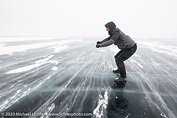Daylong excursion across Lake Baikal on the meter-thick ice after the Baikal Mile Ice Speed Festival. Maksimiha, Siberia, Russia. Sunday, March 1, 2020. Photography ©2020 Michael Lichter.