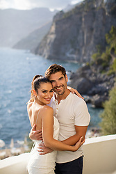 Ashley Iaconetti and Jared Haibon are in newly-wedded bliss, soaking up the sun in the Mediterranean while on their honeymoon. The love-struck couple, who exchanged vows in front of 200 guests in Rhode Island last week, are currently enjoying a getaway in Italy and Greece, staying in three different properties available on booking.com; Casa Angelina and Capri Palace in Italy and the West East Suites in Greece. Ashley, who met Jared on Bachelor In Paradise, said of the trip: 'Jared and I are lazy travelers. A perfect vacation to us is great food, a gorgeous property and a beautiful view to awe over, especially at sunset. 'We booked our entire trip through Booking.com and the site made it really easy to preview the experiences to come.' Sitting on the high cliffs of the Amalfi Coast, Casa Angelina offers beautiful modern minimalism rooms with views overlooking the Mediterranean. Guests can unwind in the panoramic outdoor pool set on one of the property's terraces, relax at the spa or dine at the gourmet restaurant servicing Mediterranean cuisine. Ashley and Jared stayed at the property from August 13 – August 17 in a former fisherman's house on the property located next to La Gavitella beach, which is accessed via the hotel's lift plus 200 steps. The couple enjoyed dinner on their private deck and looking out at the sunset along the water. Ashley and Jared then made their way to Capri where they spent four days at the Capri Palace. The property offers an outdoor mosaic swimming pool, a wellness center, a private collection of painting and sculptures and is located just 1,650 feet from the shores of Anacapri. Ashley and Jared dined at the property's 2 Michelin star Mediterranean restaurant, which is the first Michelin star restaurant the couple has been to. For the final leg of their trip, the couple will make their way to West East Suites located in the scenic village of Imerovigli. Overlooking the caldera or Aegean Sea, the suites include an elevated
