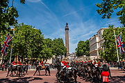 The Household Cavalry pass the Wellington Memorial as they return down the Mall - The parade on Horse Guards - His Royal Highness the Duke of York reviews the final rehearsal for the Trooping the Colour on Horseguards Parade and the Mall.