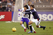 10 February 2006: Japan's Makoto Hasebe (17) and Todd Dunivant (3), of the United States, challenge for the ball. The United States Men's National Team defeated Japan 3-2 at SBC Park in San Francisco, California in an International Friendly soccer match.