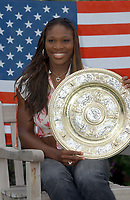 Serena Williams with the Womens Singles Champions Plate. Wimbledon Tennis Championship, Day 12, 5/07/2003. Credit: Colorsport / Matthew Impey DIGITAL FILE ONLY