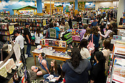 """Fans wait for author Stephenie Meyer and cast members of """"The Host"""" to arrive at the Barnes & Noble on Northwest Highway in Dallas on Tuesday, March 12, 2013. (Cooper Neill/The Dallas Morning News)"""