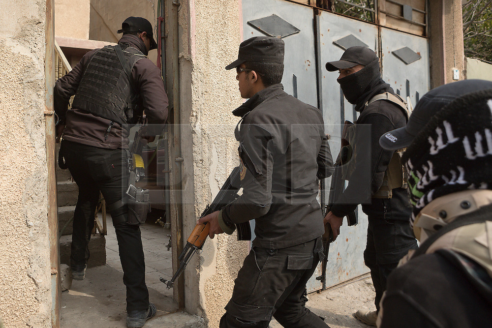 Licensed to London News Pictures. 13/02/2017. Mosul, Iraq. Officers of the Iraqi National Security Service raid the home of a suspected ISIS collaborator in an east Mosul neighbourhood.<br /> <br /> The Jihaz Al-Amin Al-Watani, roughly translated as the National Security Service or NSS, are a secretive Iraqi agency that works under the responsibility of the Ministry of Interior. Since the liberation of eastern Mosul in January 2017 the NSS have been actively hunting down ISIS members who stayed behind to continue terrorism as part of sleeper cells and residents who worked with the group during its two year occupation. Recruiting from across the country agency is responsible for internal security inside Iraq and has a broad remit to investigate and arrest everything from terrorists and foreign spies to financial criminals and drug traffickers. Photo credit: Matt Cetti-Roberts/LNP