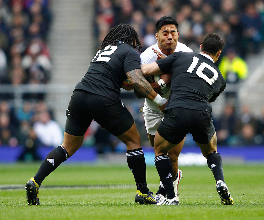 Picture by Andrew Tobin/SLIK images +44 7710 761829. 2nd December 2012. Manu Tuilagi is tackled by Ma'a Nonu (L) and Dan Carter (R) during the QBE Internationals match between England and the New Zealand All Blacks at Twickenham Stadium, London, England. England won the game 38-21.