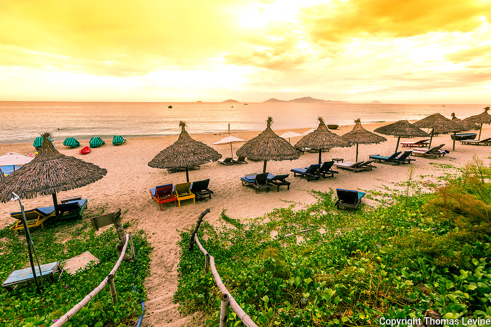 Beatuful morning on An Bang Beach with huts and lounge chairs ready for tourist to come to the beach and ocean.