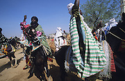 The Durbar Fantasia, is the moment where The Husa residents of Kano wear traditional dress, their local leaders and chiefs mount horses, and together with their militias display allegiance and homage to their leader, the Emir of Kano. This takes place after Ramadan. The Emir is Kano's State official political and economic feudal leader, everyone seeks to be in his pleasure, otherwise they reap the consequences..Kano is the largest Muslim Husa city, under the feudal, political and economic rule of the Emir. Kano and the other eleven northern states are under Islamic Sharia Law which is enforced by official state apparatus including military and police, Islamic schools and education, plus various volunteer Militia groups supported financially and politically by the Emir and other business and political bodies. 70% of the population live below the poverty line. Kano, Kano State, Northern Nigeria, Africa