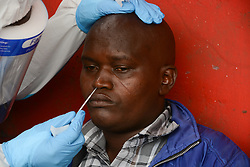 May 1, 2020, Nairobi, Kenya: A health worker performs a nose swab test on a resident during the corona virus pandemic..A mass testing of COVID-19 cases in the area of Kawangware was carried out on residents. Kenya has so far reported 411 cases of the coronavirus, 144 recoveries and 17 deaths. (Credit Image: © Dennis Sigwe/SOPA Images via ZUMA Wire)