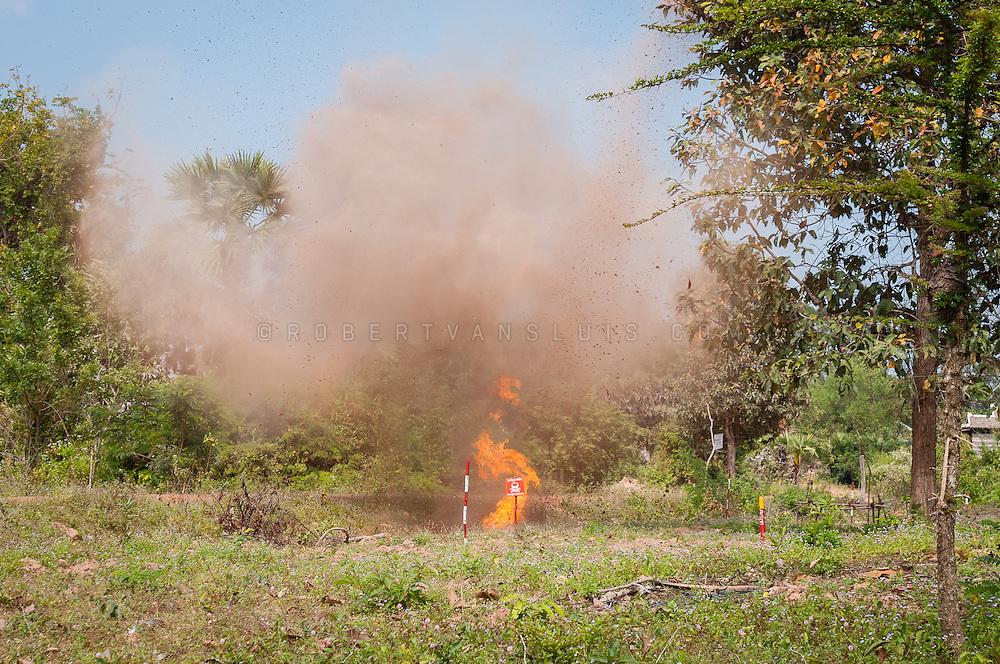 Landmine clearing - exploding landmine, Cambodia