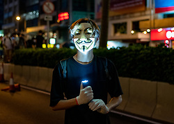Hong Kong. 4th October 2019. Pro-democracy demonstrations and march at night in Central district of Hong Kong. Masked protestor.