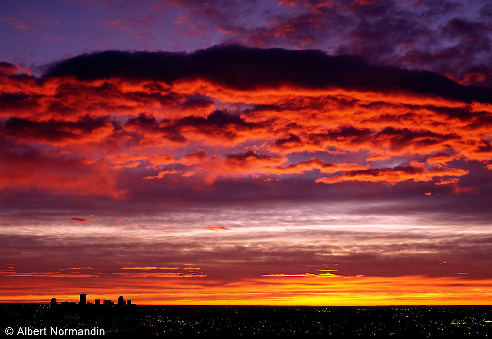 Red clouds at sunrise over Calgary