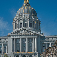 City Hall rises behind Civic Center Plaza in downtown San Francisco, California.