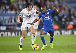 Burnley's Jack Cork (left) and Leicester City's Ricardo Pereira battle for the ball during the Premier League match at the King Power Stadium, Leicester.