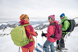 Ski tourers standing on snowy mountain, Zell am See, Austria