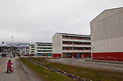 "Apartment blocks, Nuuk, Greenland. These building was built and erected in as part of the Danish parliament's, Folketinget, programme to modernize and urbanize the Greenlandic infrastructure by moving people away from the coastal settlements which were deemed ""unprofitable, unhealthy and unmodern"". The same could be said for these 'new' buildings."