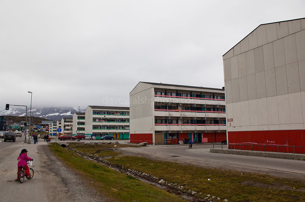 """Apartment blocks, Nuuk, Greenland. These building was built and erected in as part of the Danish parliament's, Folketinget, programme to modernize and urbanize the Greenlandic infrastructure by moving people away from the coastal settlements which were deemed """"unprofitable, unhealthy and unmodern"""". The same could be said for these 'new' buildings."""