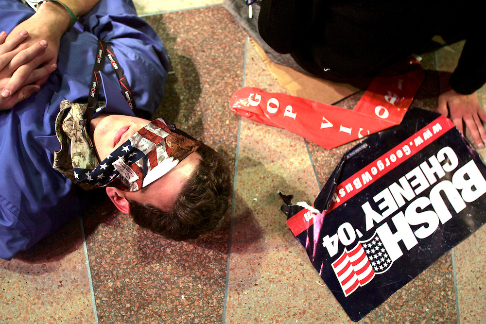 Bushed..A George Bush campaign worker sleeps on the floor at the Reagan International Trade Building in Washington D.C. on election night at about 4 am after waiting for George Bush to make an appearance before the crowd.  Bush did not appear until 3 pm the next afternoon.