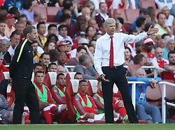 14 August 2016 London - Premier League Football : Arsenal v Liverpool :<br /> Arsenal manager Arsene Wenger gestures on the sidelines <br /> Photo: Mark Leech