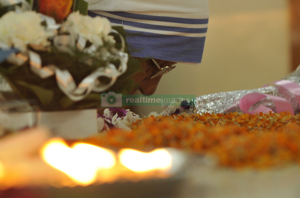 August 26, 2017 - Kolkata, West Bengal, India - An Indian nun from the Catholic Order of the Missionaries of Charity prays at the headstone on the 107th anniversary of the birth of Mother Teresa on her tomb at the Indian Missionaries of Charity house in Kolkata on August 26, 2017.India. (Credit Image: © Debajyoti Chakraborty/NurPhoto via ZUMA Press)
