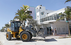 Miami Beach workers begin the process removing the sand from Ocean Drive in the Hurricane Irma aftermath on Tuesday, September 12, 2017. Photo by David Santiago/El Nuevo Herald/TNS/ABACAPRESS.COM