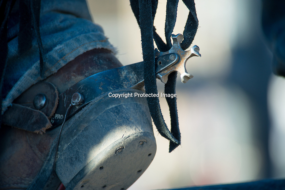 A worn boot and spur on a cowboy at Upper Yellowstone Roundup Association rodeo in Gardiner, Montana on the northern border of Yellowstone National Park.