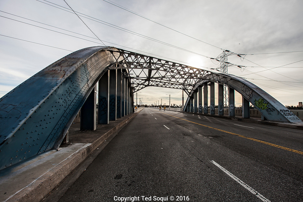"""LA's iconic 6th street viaduct/bridge is now closed for public use. Preparation for demolition work begins today. The bridge opened in 1932 and is now falling apart due to a form of """"concrete cancer"""" which makes the bridge unstable."""