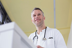 Doctor looking away and smiling