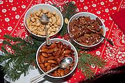 Bowls of pecan cashew and almond nuts. Annual Swedish Julbord at the American Swedish Institute Minneapolis Minnesota USA