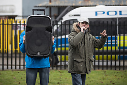 © Licensed to London News Pictures . 20/01/2018. Doncaster, UK. EDL leader IAN CROSSLAND (r) speaks . Far-right street protest movement , the English Defence League ( EDL ) , hold a demonstration , opposed by anti-fascists , including Unite Against Fascism ( UAF ) in a park in Hexthorpe in Doncaster . EDL supporters chanted anti-Roma slogans as they marched through the town . Photo credit: Joel Goodman/LNP
