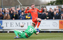 Aaron Ramsdale of AFC Wimbledon makes a diving save at the feet of Jed Wallace of Millwall - Mandatory by-line: Arron Gent/JMP - 16/02/2019 - FOOTBALL - Cherry Red Records Stadium - Kingston upon Thames, England - AFC Wimbledon v Millwall - Emirates FA Cup fifth round proper