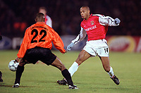 Thierry Henry (Arsenal) Isaac Okoronkwo (Shakhtar Donetsk). Shakhtar Donetsk 3:0 Arsenal, UEFA Champions League, Group B, Centralny Stadium, Donetsk, Ukraine, 7/11/2000. Credit Colorsport / Stuart MacFarlane.