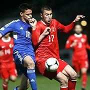 Andorra's Marc Vales (L) and Turkey's Burak Yilmaz (R) during the FIFA World Cup 2014 qualification match Andorra betwen Turkey at the Andorra la Vella stadium in Andorra March 22, 2013. Photo by TURKPIX