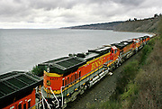 BNSF engines, pulling freight, head north along Puget Sound towards Edmonds. (Ken Lambert / The Seattle Times)
