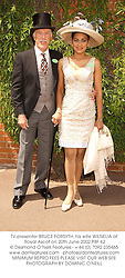 TV presenter BRUCE FORSYTH, his wife WILNELIA at Royal Ascot on 20th June 2002.PBF 62