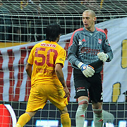 Galatasaray's Engin Baytar (L) and Sivasspor's goalkeeper Milan Borjan (R) during their Turkish Superleague soccer match Galatasaray between Sivasspor at the Turk Telekom Arena at Aslantepe in Istanbul Turkey on Saturday 26 November 2011. Photo by TURKPIX